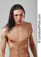 Young sexy man in towel