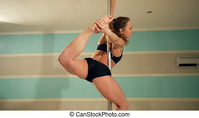 Young sexy pole dance woman. Underwear. Slow motion