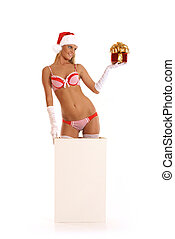 Young sexy Santa gets out of a box isolated on white
