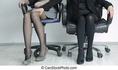 young sexy secretary touching her female boss to the knee. Office lesbian harassment
