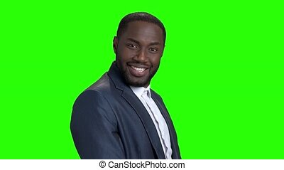 Young sexy stylish businessman on green screen. Smiling...