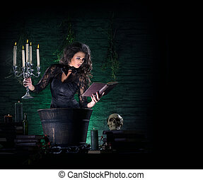 Young sexy witch making the witchcraft in the dungeon -...