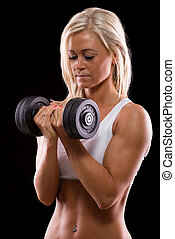Young sexy woman dumbbells exercises