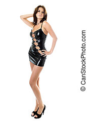Young sexy woman in black leather dress. Isolated