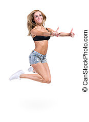 Young sexy woman in denim shorts jumping with thumbsup