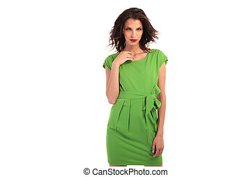young sexy woman in green dress posing