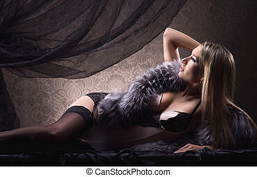 Young sexy woman in lingerie over vintage background