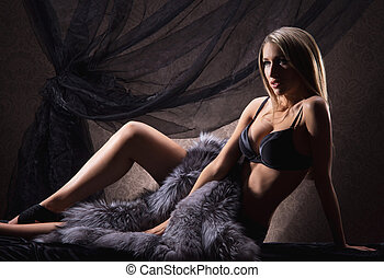 Young sexy woman in lingerie posing in vintage interior