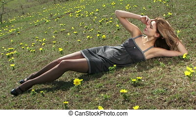 Young Sexy Woman Lying On The Grass At Meadow