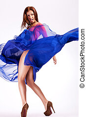 woman model in a fluttering dress screaming