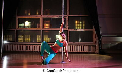 Young sexy woman pole dance