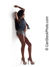 young sexy woman posing in jeans