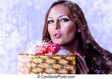 Young sexy woman santa with gift