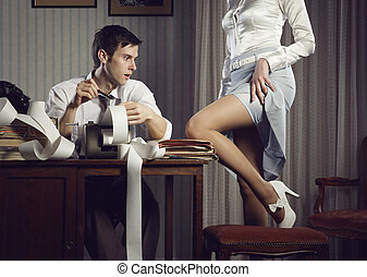 Young sexy woman shows a leg for business man at desk