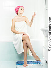 Young sexy woman sitting in bathroom having shower