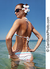 young sexy woman sunbathing