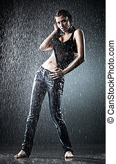 Young sexy woman water studio photo. Contrast colors.