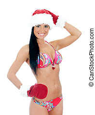 Young sexy woman wearing bikini and christmas hat and gloves . Isolated on white