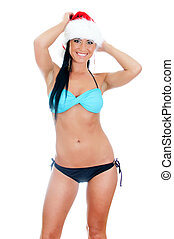 Young sexy woman wearing bikini and christmas hat . Isolated on white