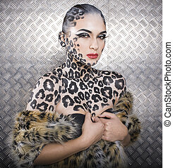 young sexy woman with leopard make up all over body, cat...