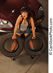 Young sexy woman with the tires