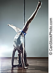 Young sexy woman - Young sexy pole dance woman. On wall...