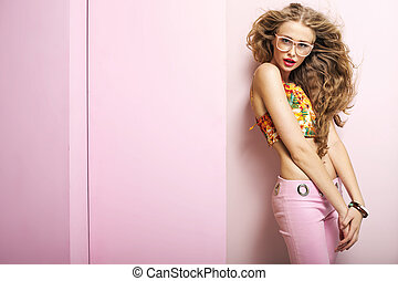 Young shapely woman in pink room