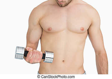 Young shirtless man exercising with dumbbell