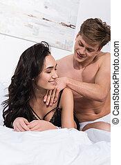 man giving massage to girlfriend