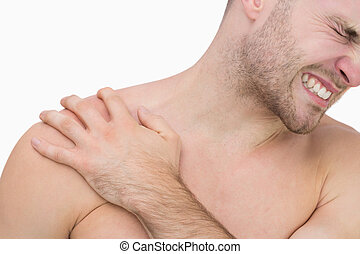 Young shirtless man with shoulder pain