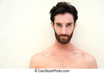 Young shirtless sexy man with beard - Close up portrait of a...