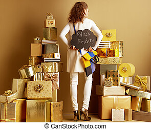 young shopper woman with Black Friday sign