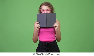 Young shy nerd woman with curly blond hair hiding behind...
