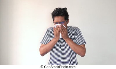 young sick man in casual dress coughing and sneezes ,