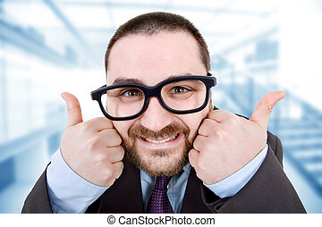 thumbs up - young silly business man going thumbs up