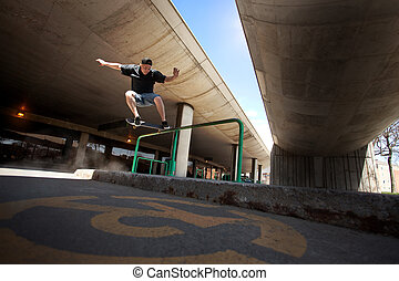 Skateboarder doing a Crooked Grind trick on a Rail - Young...
