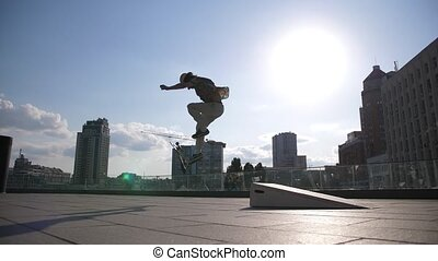 Young skater falling doing kickflip trick outside - Active...