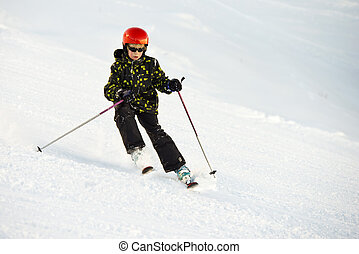 Young skier during a decent