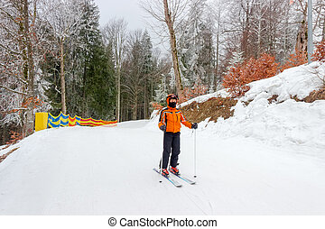 Young skier on start of a piste