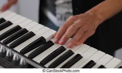 young skilled man plays piano