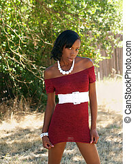 Young skinny Black woman red knit dress