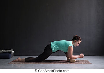 Young slim girl, doing horse rider exercise, anjaneyasana pose, working out.