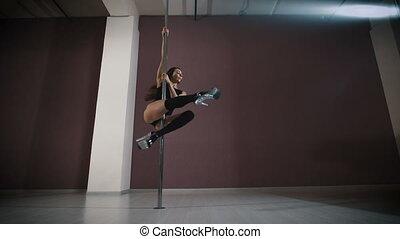 Young slim pole dance woman.