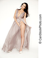 Young slim sexy woman in brown dress isolaten on white backgroun