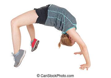 Young slim woman doing gymnastics