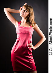 Young slim woman in pink dress