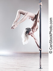 Young slim woman - Young slim pole dance woman. Bright white...