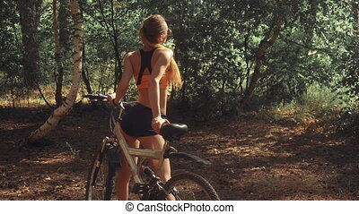slim woman with a Bicycle