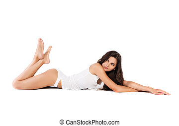Young slim woman with perfect body on white background