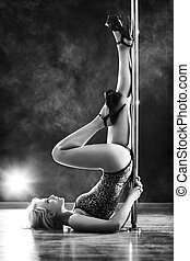 Young slim woman - Young slim pole dance woman. Black and...